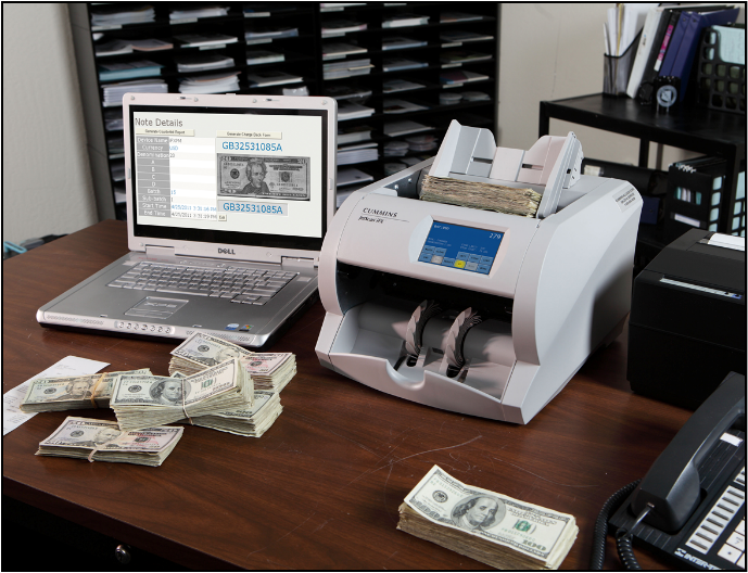 Laptop and Money Counter on Desk